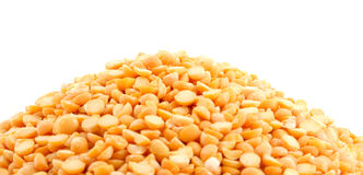 Pile of yellow split peas on white Royalty Free Stock Image