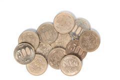 Pile of 500 yen coins japanese money on white background. stock photos