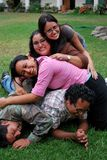 Pile of Young Hispanic friends royalty free stock photography