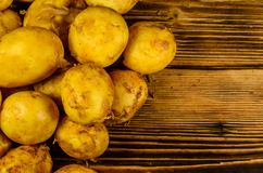 Pile of the young potato on wooden table. Top view Stock Images