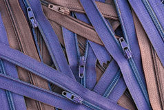 Pile of zippers background Stock Photography