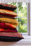 Piled Authentic Pillows In Front Glass Window Stock Photo