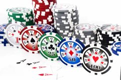 Piled chips with poker of ace Stock Image