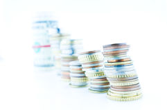 Piled coins Stock Images