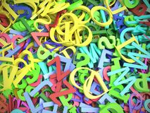 Piled colorful alphabet fonts. Pile of assorted colorful latin alphabet fonts Stock Image