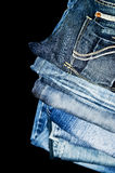 Piled denim jeans Stock Photography