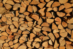Piled firewood, wood texture Stock Photos