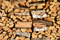 Piled firewood, wood texture Royalty Free Stock Images