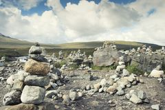 Piled good luck stones. Stony Pilgrims in hight mountains of Scotland royalty free stock photography