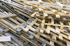 Piled into a heap of wooden pallets Stock Photos