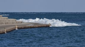 Piled Ice along Montrose Harbor Seawall Walk. This is a Winter picture of ice piled along the seawall walk along Montrose Harbor located in Chicago, Illinois in royalty free stock photo