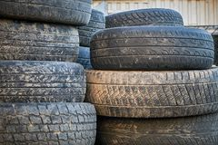 Piled old dirty car tires royalty free stock photography