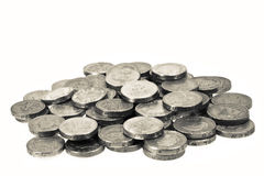 Piled one pound coins. Macro Stock Image