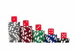 Piled poker chips with dice Stock Photos