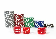 Piled Poker Chips With Dice Royalty Free Stock Image
