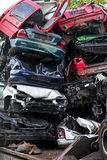 Piled scrap cars on the junkyard, vertical, concept for insuranc. E or waste management Stock Photography
