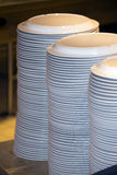 Piled stack of clean dishes plates Stock Photos