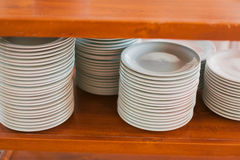 Piled stack of clean dishes plates Royalty Free Stock Image