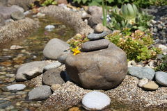 Piled stones. In a garden Stock Images