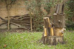 Piled stump seats in garden or park Stock Image