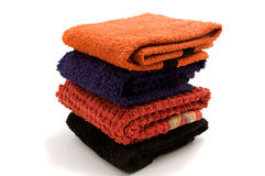 Piled towels. On a white background Stock Photos