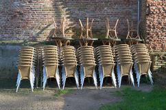 Piled up chairs and tables Stock Images