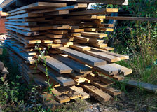 Piled up planks Stock Image