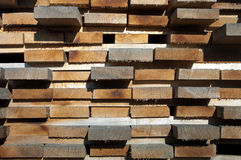 Piled up planks Stock Photography