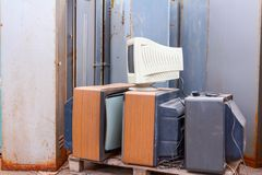 Old, used and obsolete TV and PC monitor with cathode technology. Piled up several retro, old vintage TV and one PC display, they are ready for recycling royalty free stock photos