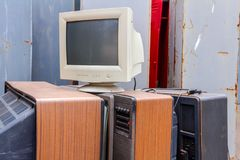 Old, used and obsolete TV and PC monitor with cathode technology. Piled up several retro, old vintage TV and one PC display, they are ready for recycling stock photography