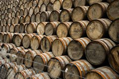 Piled up whisky barrels stock photos