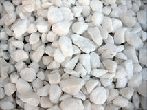 Piled of white stones. Textured background of pile of small white stones Royalty Free Stock Photo