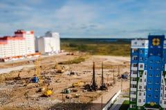 Piledrivers on construction site. pile field. Tilt-shift photo stock photos