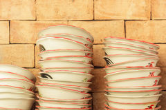 PILEof brown bowl in warehouse. Royalty Free Stock Photo