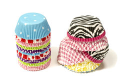 Piles of all colors cupcake paper cups. Stock Images