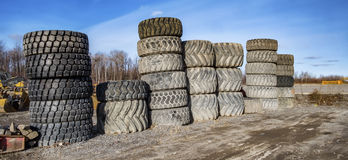 Piles of big tires Stock Photos