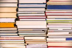 Piles of books background, back to school, college university concept. Piles of books background, back to school, college, university concept stock photo