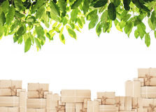 Piles of boxes with green leaf, isolated on white background Stock Photo