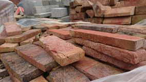 Piles of bricks red grey cracked Royalty Free Stock Photos