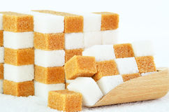 Piles of brown and white sugar cubes. Piles of brown and white sugar stock image