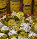 Piles of cans at a shopwindow in Sarlat-la-Caneda. Foie gras is a famous product from stock image