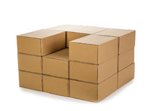 Piles of cardboard boxes on a white background Stock Photography