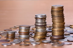 Piles of coin increasing in height Stock Photography