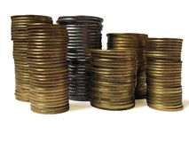 Piles of coins. Over white Royalty Free Stock Photography