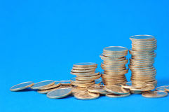Piles of coins. On blue background Stock Photography