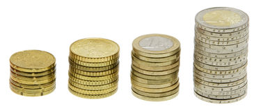 Piles of coins rising higher Royalty Free Stock Photo