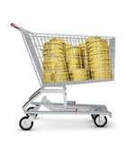 Piles of coins in shopping cart Royalty Free Stock Photo