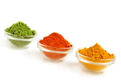 Piles of color spices Stock Images
