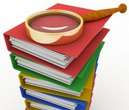 Piles of colored office ring binders with magnifying glass Royalty Free Stock Photos