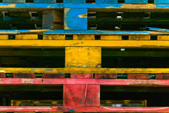 Piles of colored wooden pallets stock image